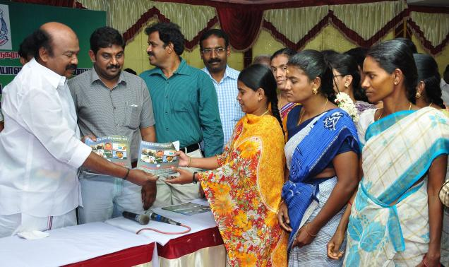 Mayor V.V. Rajan Chellappa distributing free study materials for competitive examinations to candidates at the free coaching session in the city on Tuesday./ Photo: R. Ashok / The Hindu