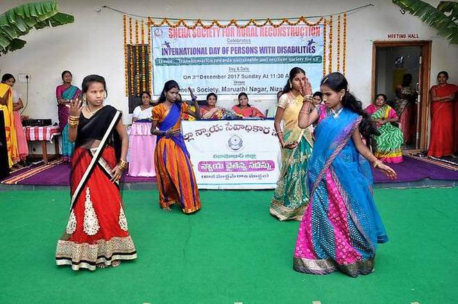 Display of skills: Differently-abled children staging a cultural show at the Sneha Society for Rural Reconstruction in connection with the International Day of Persons with Disabilities observance in Nizamabad on Sunday. | Photo Credit: K_V_RAMANA
